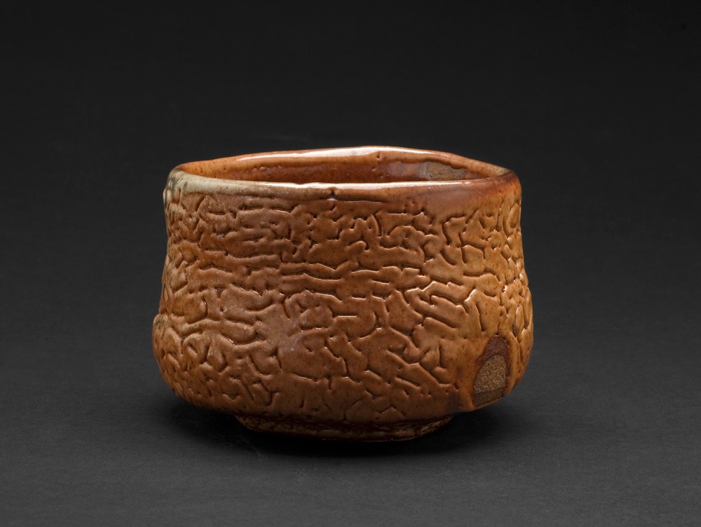 Lisa Hammond    Red Shino Faceted Chawan  , 2013 Crank clay thrown cut and stretched, hand cut foot with red pine knife, fired in reduction, oil fired soda atmosphere to 1300 degree 3.25 x 4.25 inches 8.3 x 10.8 cm LHa 4