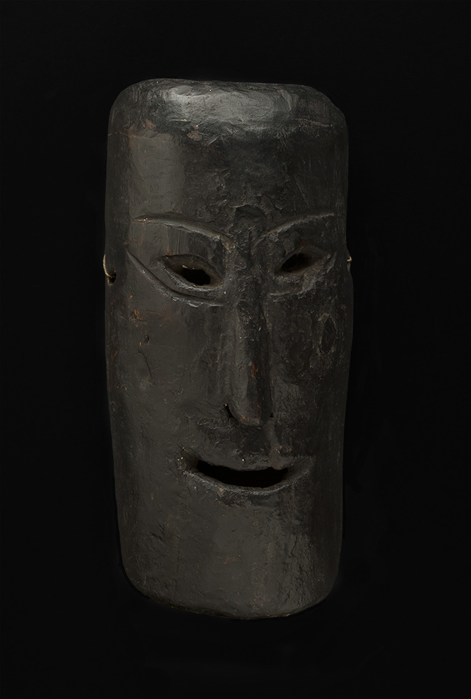 Masks    Nepal - West Nepal  , Early 20th C. Wood with black paint 12 x 6 x 3.5 inches 30.5 x 15.2 x 8.9 cm M 107s