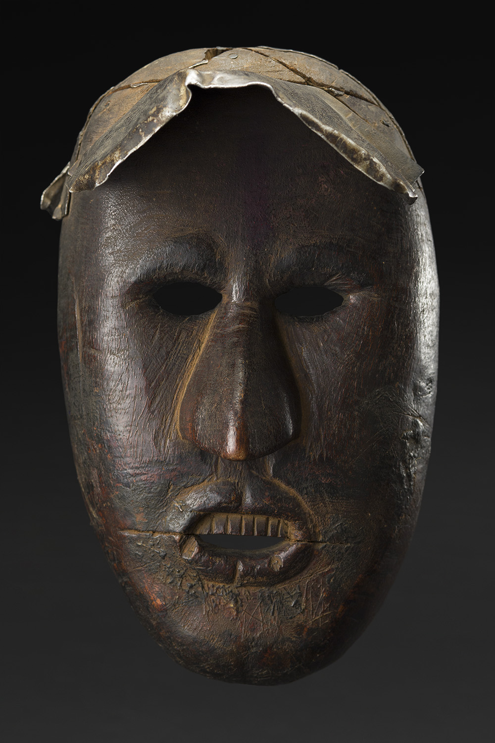 Masks    Nepal  , Early 20th C. Wood, metal 9 x 5.5 x 6.5 inches 22.9 x 14 x 16.5 cm M 223s