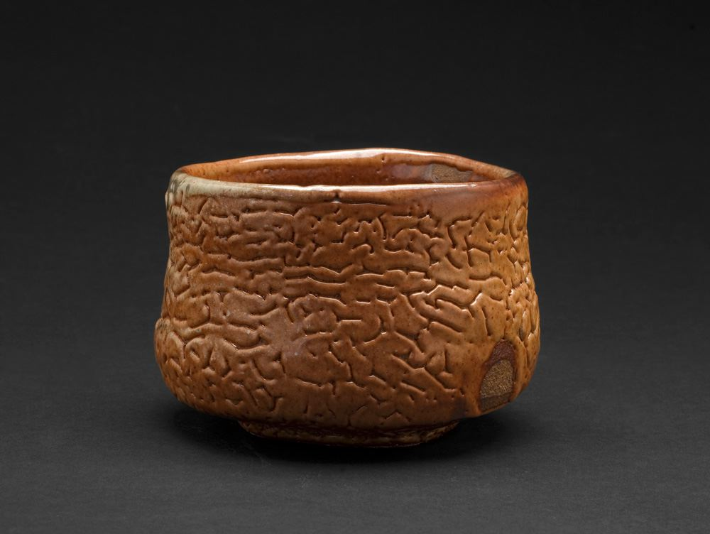 Lisa Hammond Red Shino Faceted Chawan, 2013 Crank clay thrown cut and stretched, hand cut foot with red pine knife, fired in reduction, oil fired soda atmosphere to 1300 degree 3.25 x 4.25 x 4.25 inches 8.3 x 10.8 x 10.8 cm LHa 4