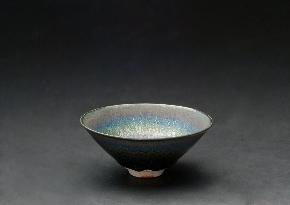 Wasaburo Takahashi Seiran Tenmoku-yu Chawan, 2011 Finishing: double dipping with Tenmoku glaze (black colored glaze) and Seiran glaze (blue colored glaze); glaze: Tenmoku-glaze (iron glaze); firing: reduction firing in gas kiln at 1250 C, fired twice 2.5 x 6 x 6 inches 6.4 x 15.2 x 15.2 cm WTa 1