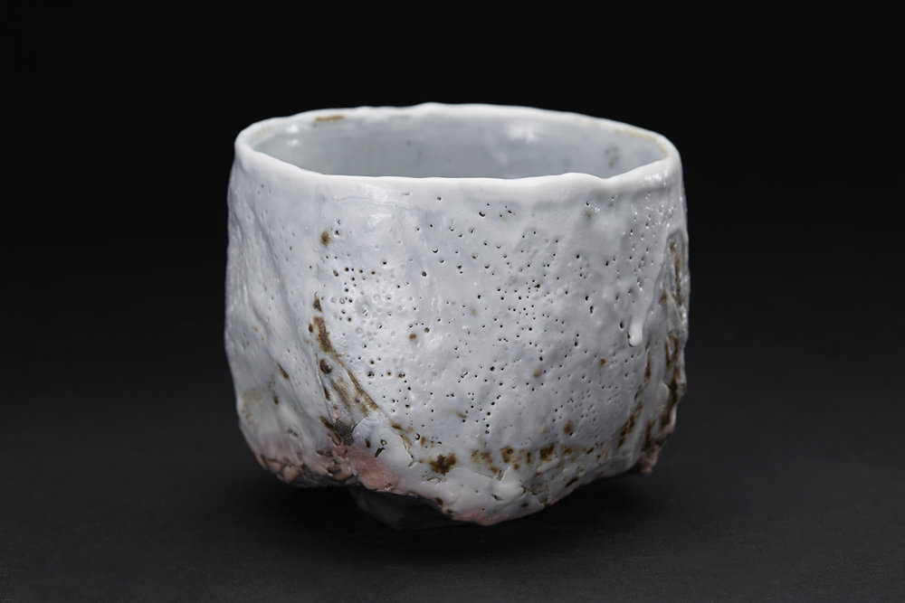 Margaret Curtis Chawan, 2016 Stoneware, reduction fired in brick built oil kiln at 1300 Celsius. Thrown and altered, black body with shino glaze. 3.5 x 4 x 4 inches 8.9 x 10.2 x 10.2 cm MCu 3
