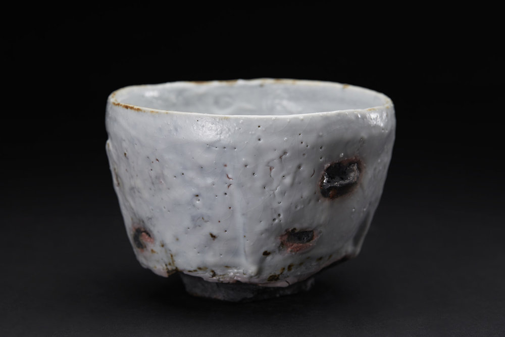 Margaret Curtis Chawan, 2016 Stoneware, reduction fired in brick built oil kiln at 1300 Celsius. Thrown and altered, black body with shino glaze. 3.5 x 5 x 5 inches 8.9 x 12.7 x 12.7 cm MCu 4