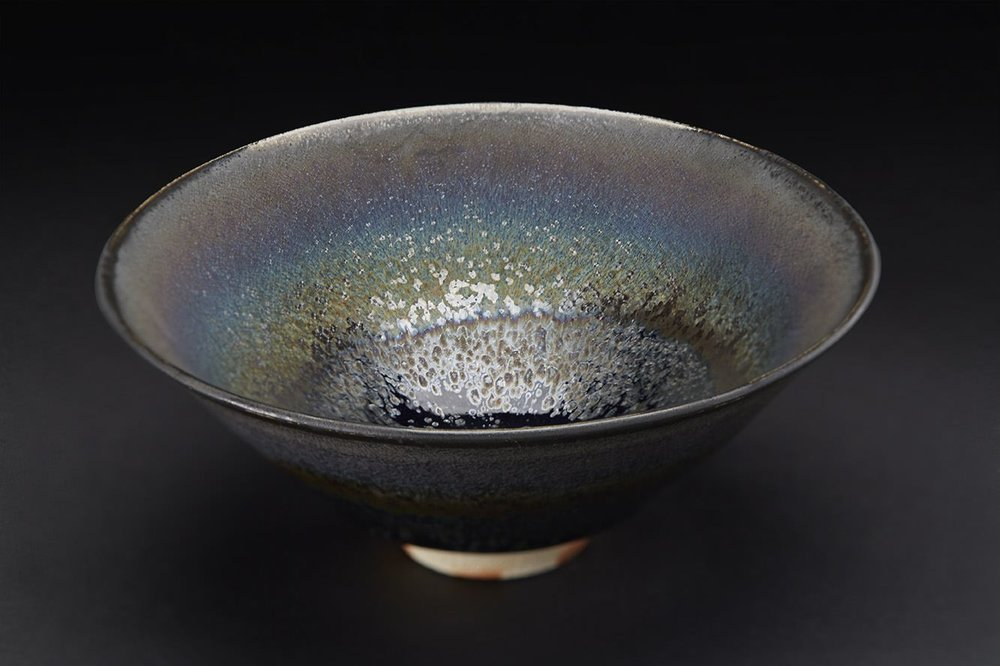 Wasaburo Takahashi    Seiran Tenmoku-yu Chawan  , 2011 Finishing: double dipping with Tenmoku glaze (black colored glaze) and Seiran glaze (blue colored glaze); glaze: Tenmoku-glaze (iron glaze); firing: reduction firing in gas kiln at 1250 C, fired twice 2.5 x 6 x 6 inches 6.4 x 15.2 x 15.2 cm WTa 1