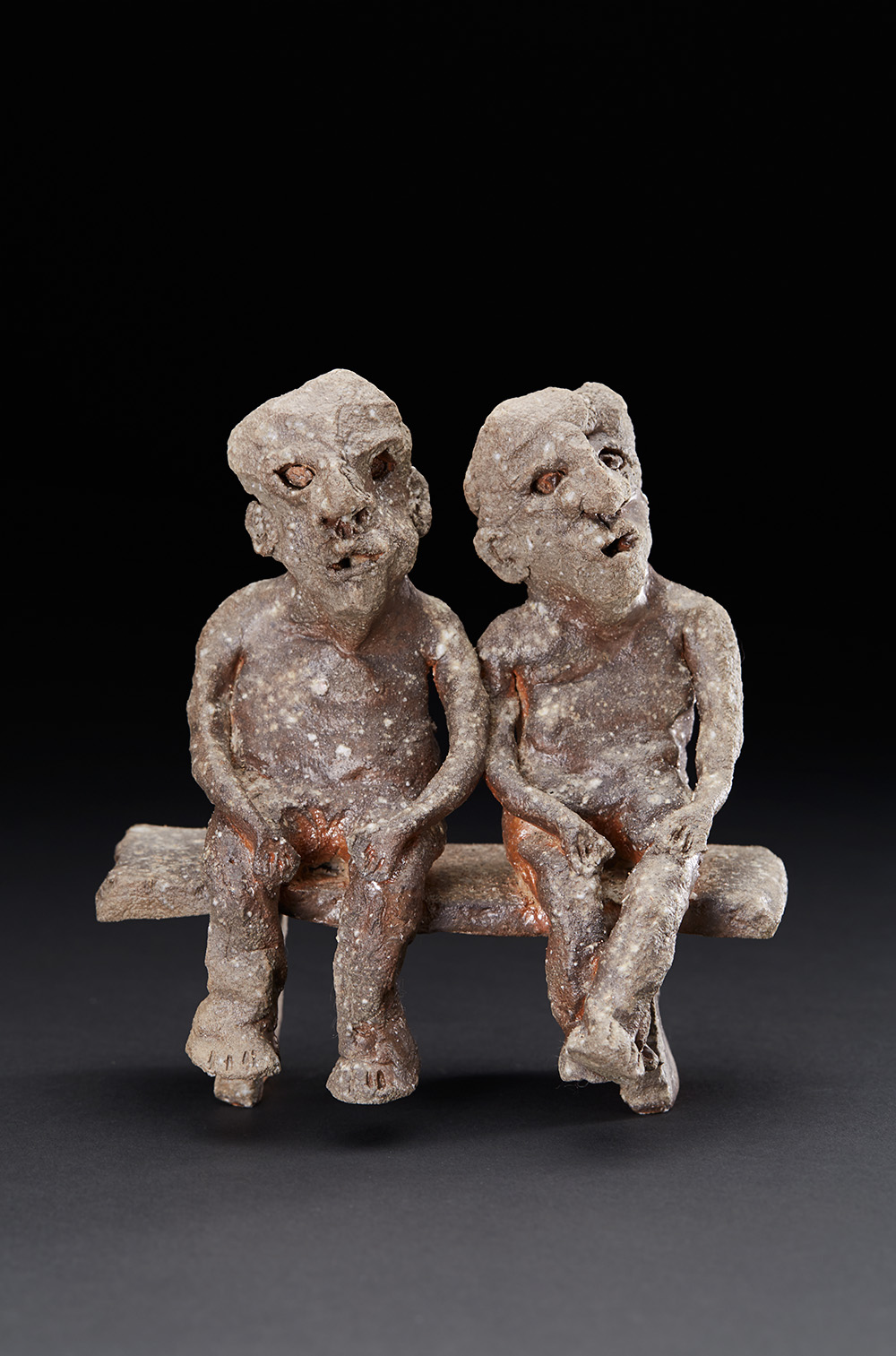 Chrissy Callas    2 Benched Men  , 2005 Ceramic 7.5 x 7 x 3.5 inches 19.1 x 17.8 x 8.9 cm CCa 39