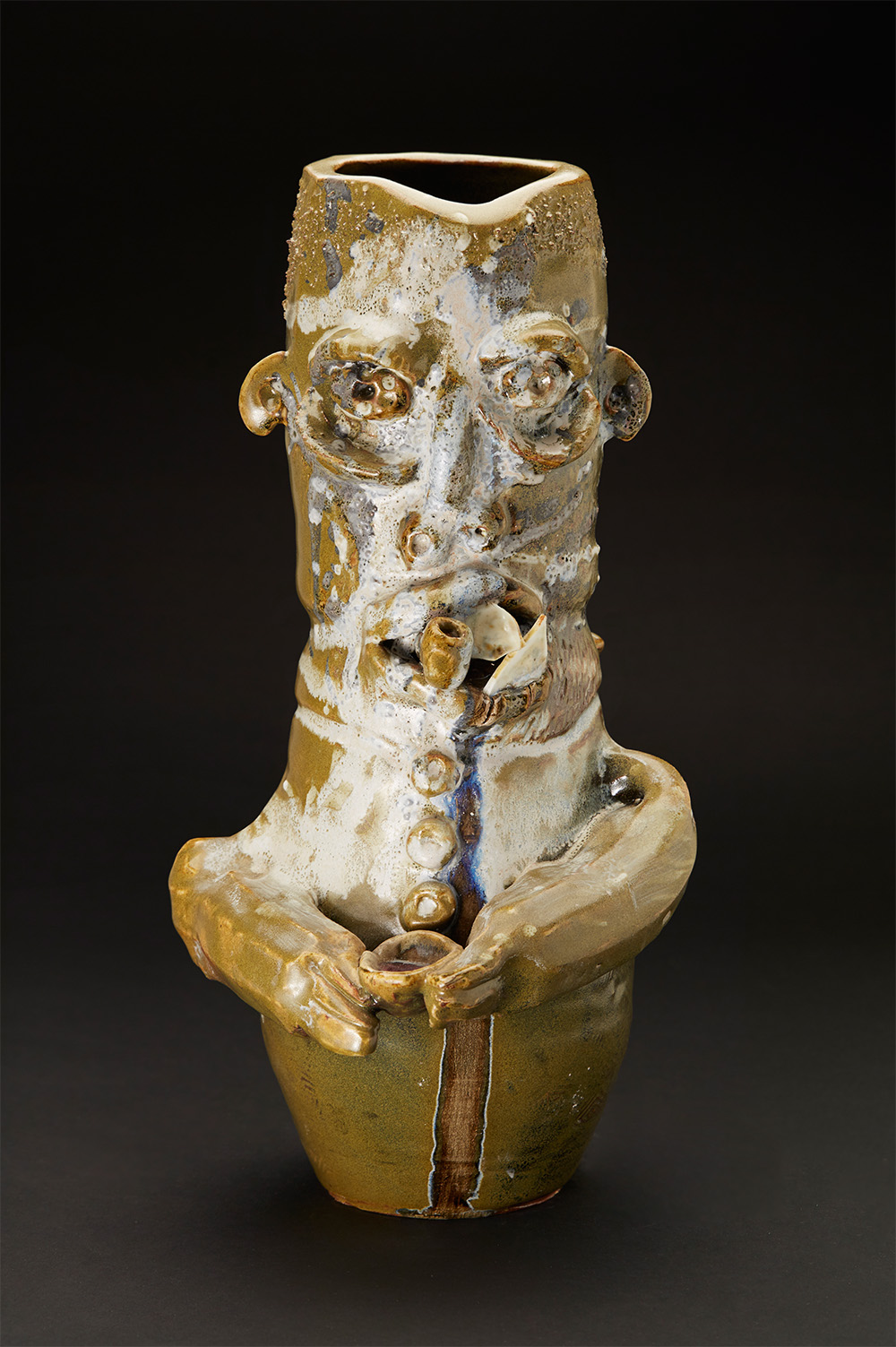 Jim McDowell    Gonna Lay Down My Sword And Shield  , 2016 Ceramic, fired in a gas soda kiln; made of high fire clay, glazed with Jack Troy root beer glaze and white shino; embellished with blue glass 16 x 7.5 x 9 inches 40.6 x 19.1 x 22.9 cm JMcD 10