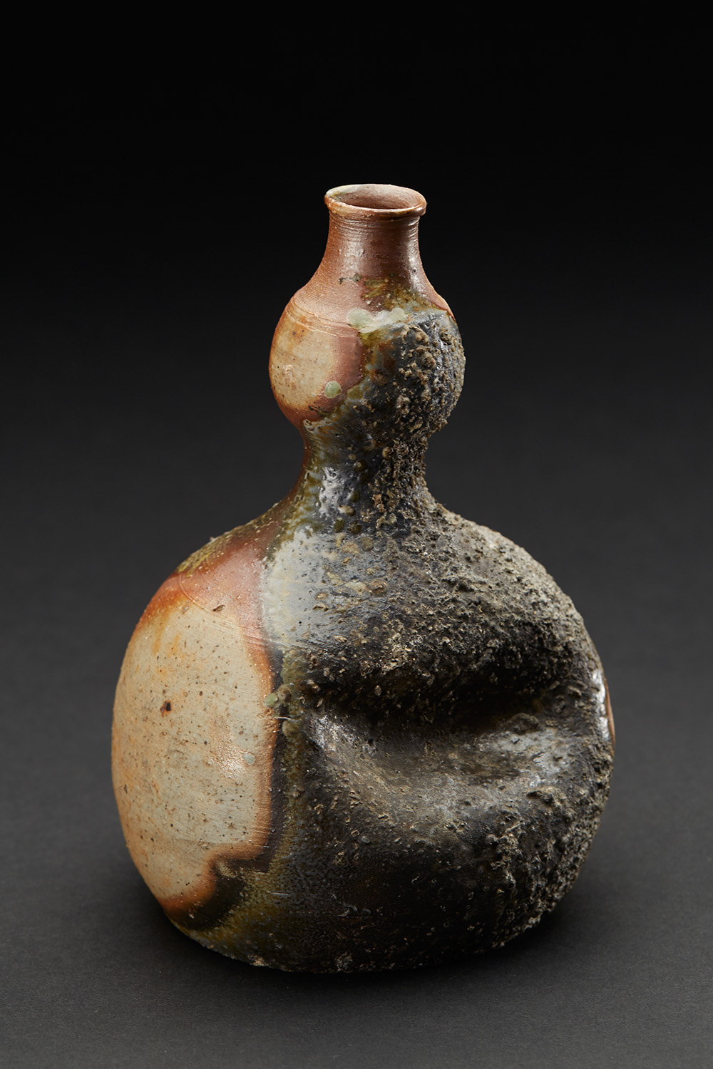 Japanese Ceramics    Bizen Indented Ash Covered Tokkuri  , 2017 Wood fired stoneware with melted ash 6 x 4 x 3.5 inches 15.2 x 10.2 x 8.9 cm JCer 44  $300