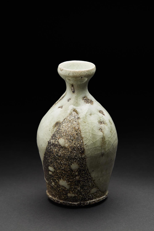 Katsumi Kako    Shizuku Tokkuri  , 2006 Oribe glaze, woodfired ceramic 6.5 x 3.5 x 3.5 inches 16.5 x 8.9 x 8.9 cm KKa 3  $400