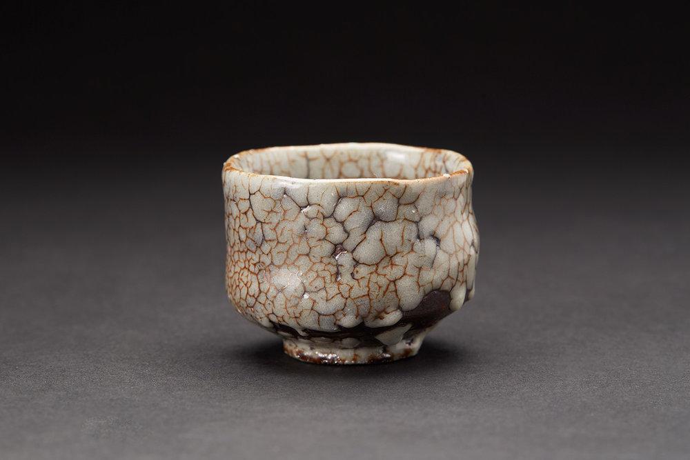 Masafumi Onishi    Guinomi  , 2016 Ceramic with cracked celadon 2 x 2.5 x 2.5 inches 5.1 x 6.4 x 6.4 cm MOni 1  $200