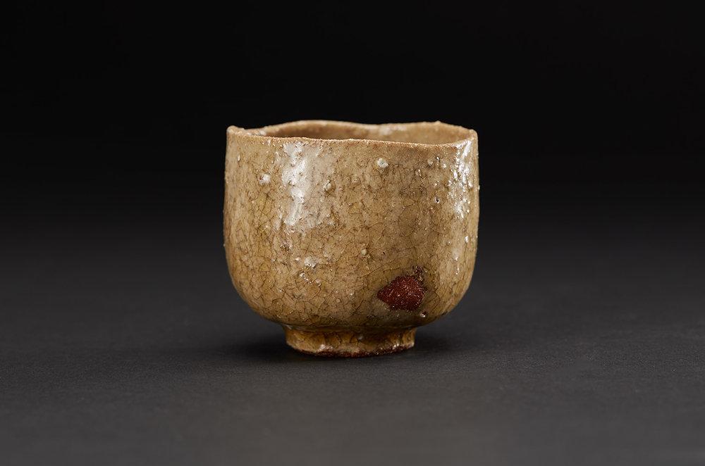 Akira Takeuchi    Guinomi  , 2018 Mogusa clay, red clay, ash glaze 2.25 x 2.5 x 2.5 inches 5.7 x 6.4 x 6.4 cm TaA 8  $190
