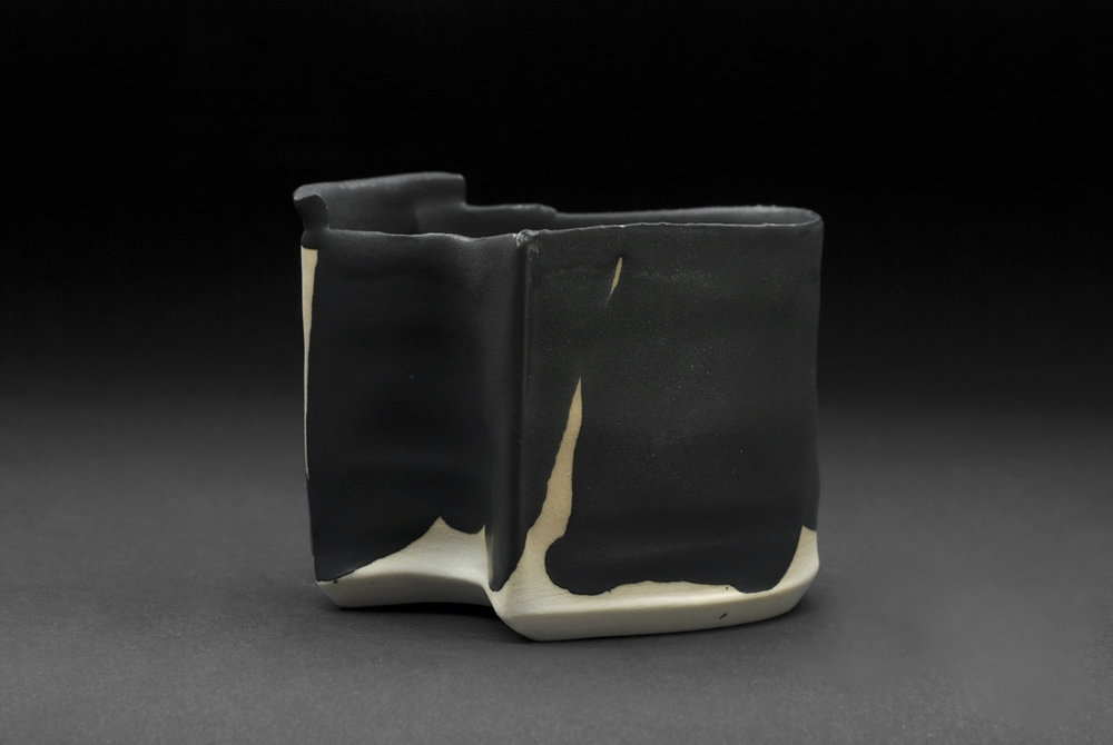 Robert Fornell  Stealth 2  , 2012 Porcelain, black glaze 3.5 x 4.25 inches 8.9 x 10.8 cm RFo 115