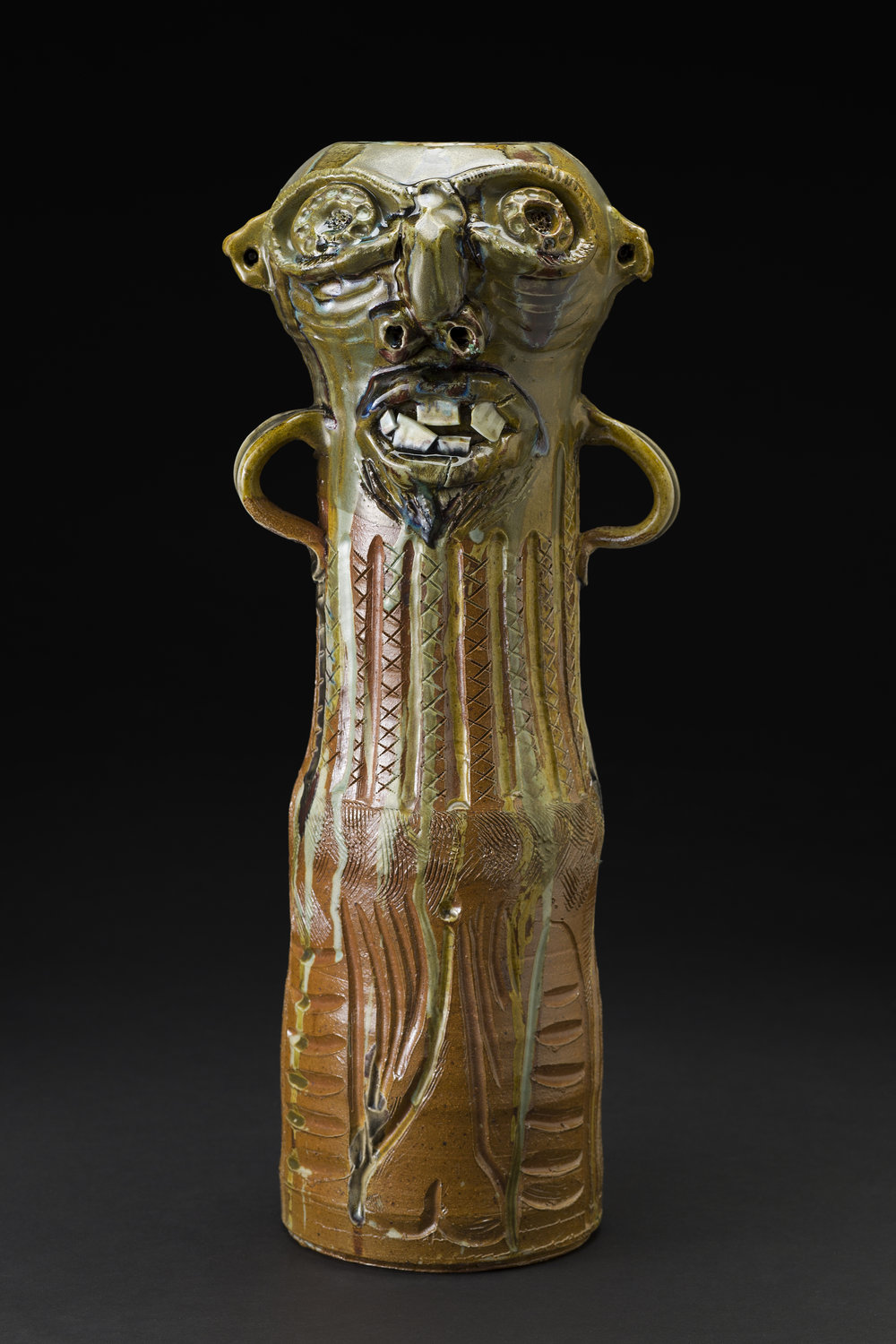 Jim McDowell  Mad Black Man  , 2015 Soda-fired clay in a gas kiln, amber celadon glaze, red iron oxide, and blue-stained glass runs 18.75 x 7.5 x 7 inches 47.6 x 19.1 x 17.8 cm JMcD 7
