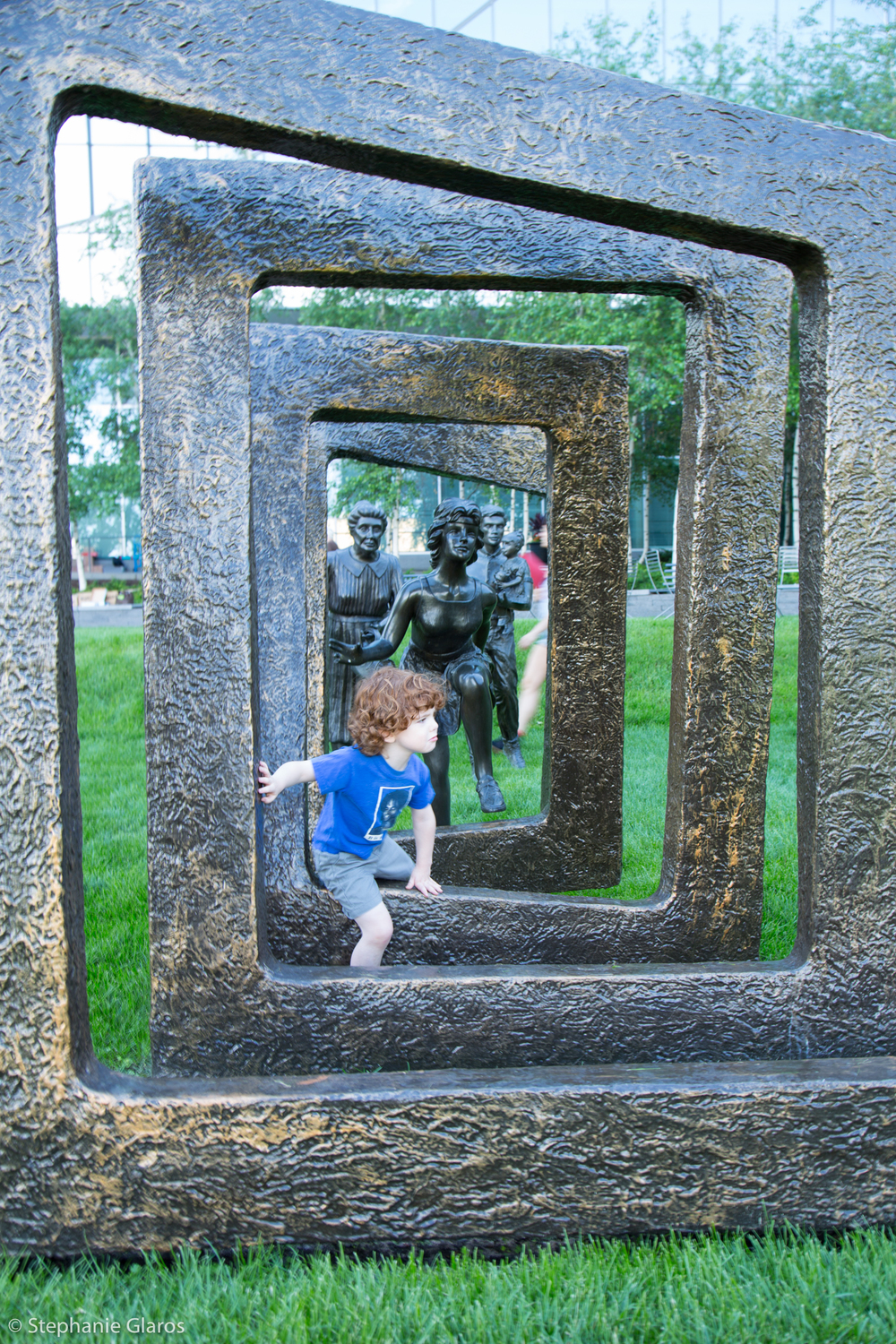 Child playing in sculpture at Yoga Rocks the Park outdoor yoga event, Minneapolis