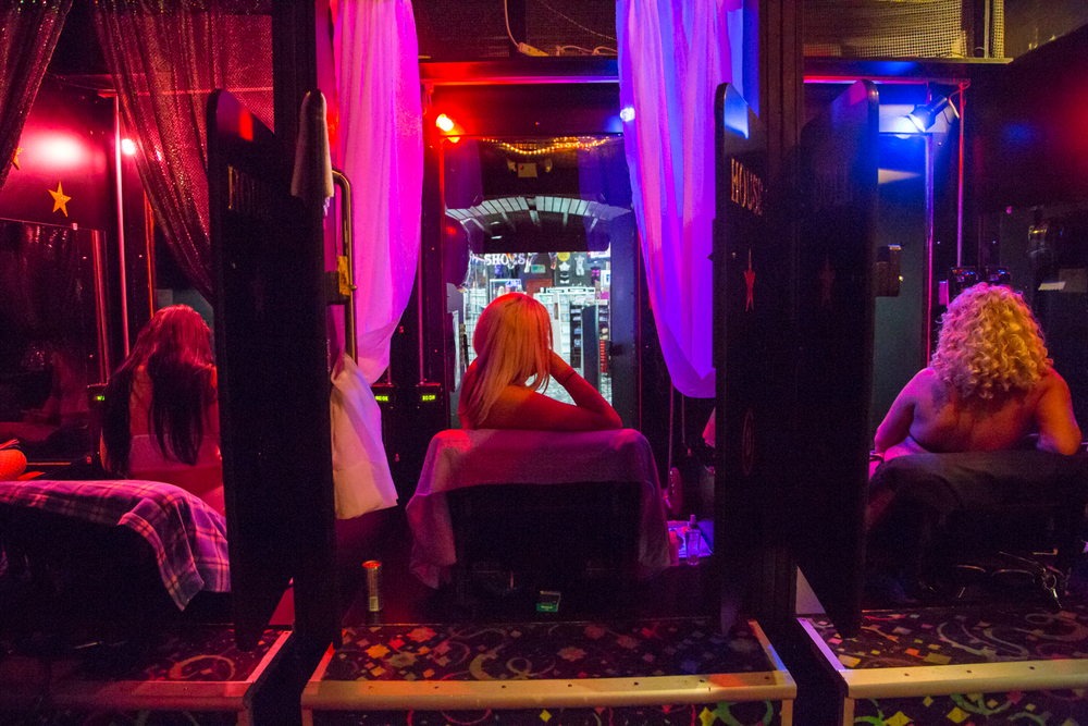Peep show performers wait for customers