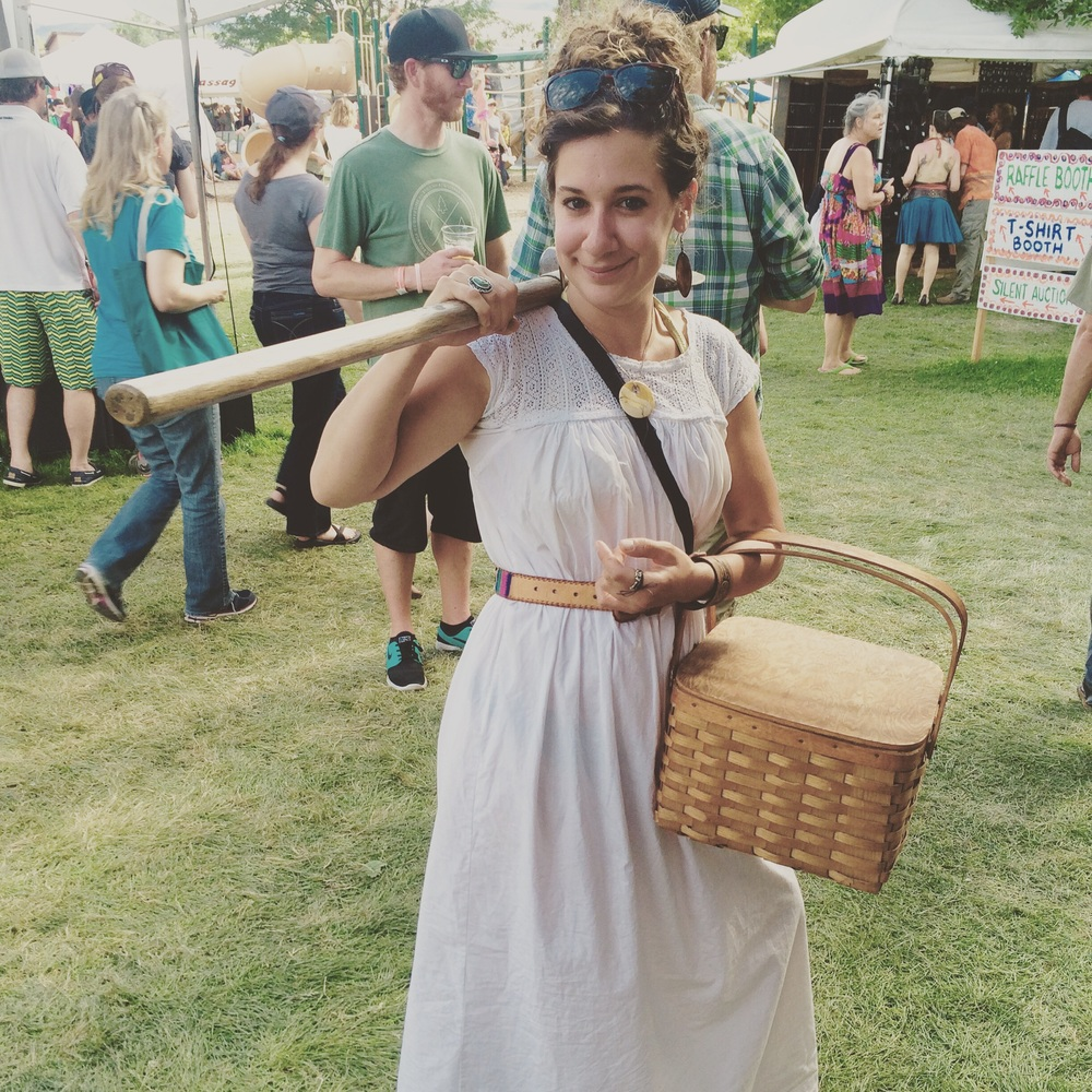 Shannon with a basket full of quiche and the prize ax from the Women's Wood Chopping Competition... yeah Alyssa Barker, nice choppin!!