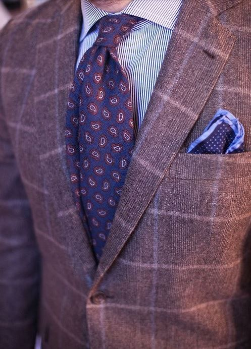 Paisley tie paired with a subtle plaid blazer to blend the two for a uniformed look.