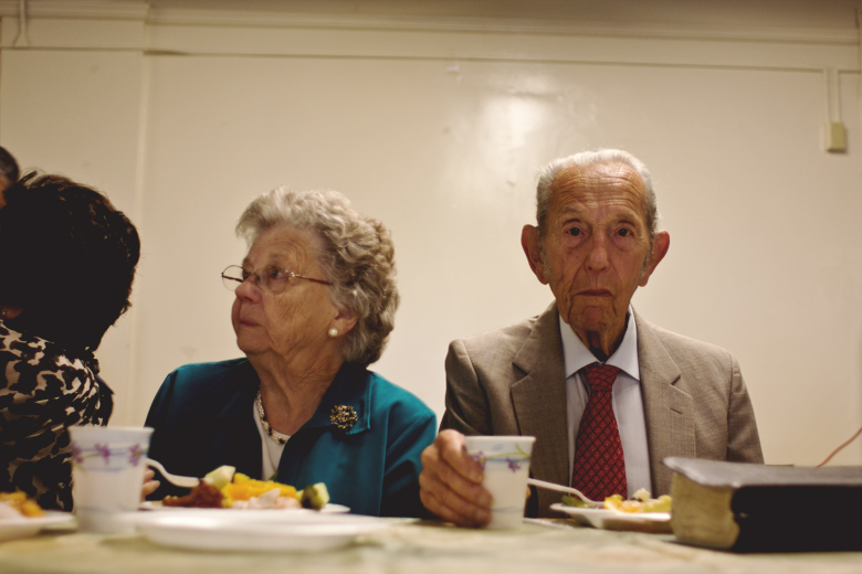After his last sermon on May 15th, Camping and his wife Shirley enjoy a final meal with the congregation.