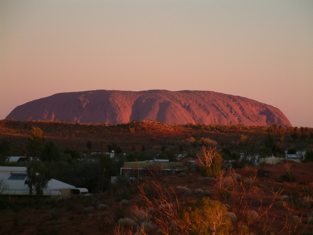 Uluru at sunset as seen from the hill behind our campsite at Yulara.20.2 kms away