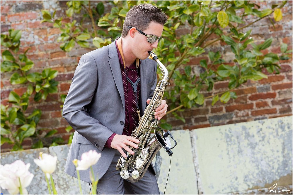 David (The Sax Walker) entertaining the wedding guests at Glemham Hall in Suffolk.