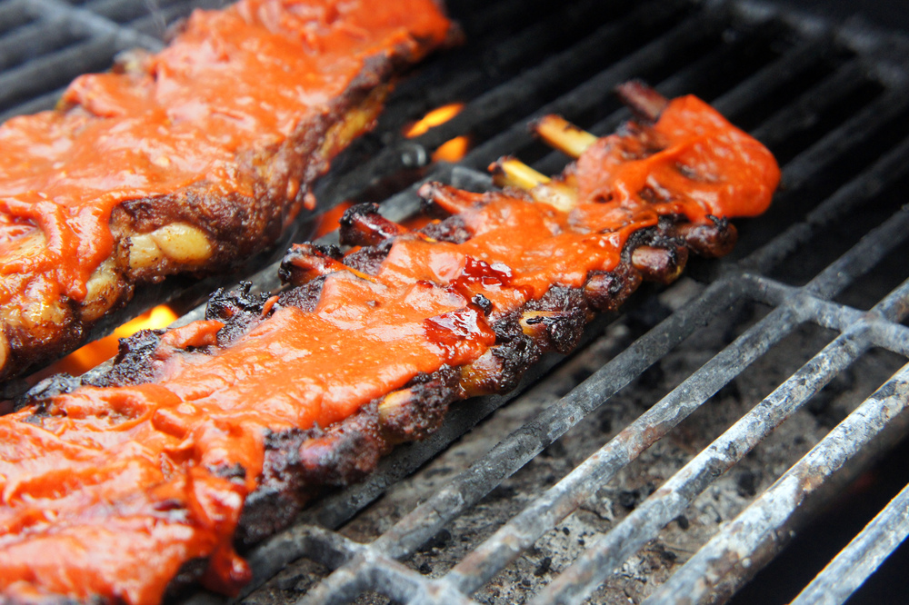 Fiery Chipotle Peach Pork Ribs, slow roasted and finished on the grill, these puppies fall off the bone!