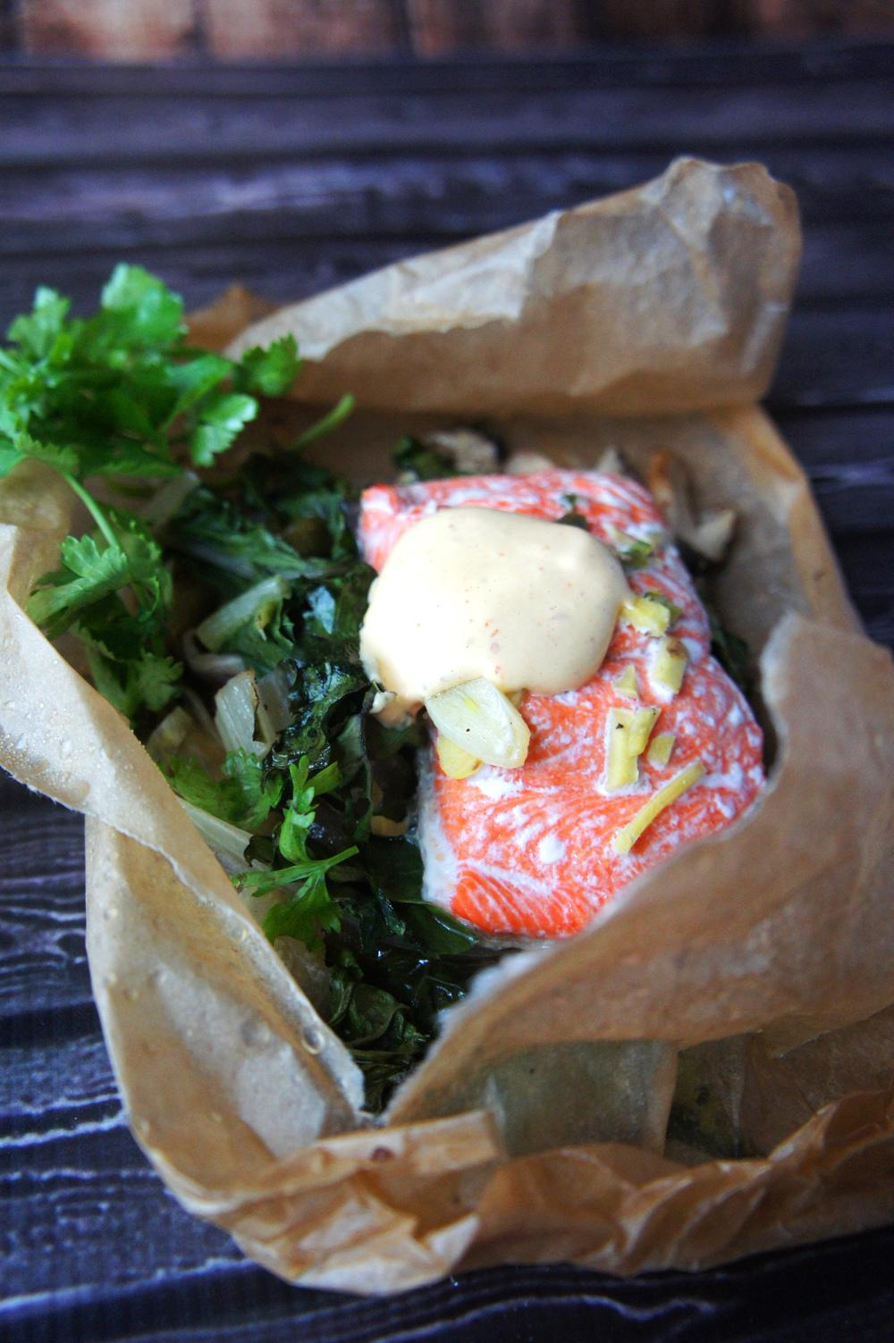 Salmon in Parchment with Shiitake Mushrooms, Swiss Chard, & Sriracha Aioli