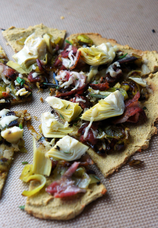 Paleo pizza crust, Nut free! Caramelized Leeks, Bacon, Artichokes.