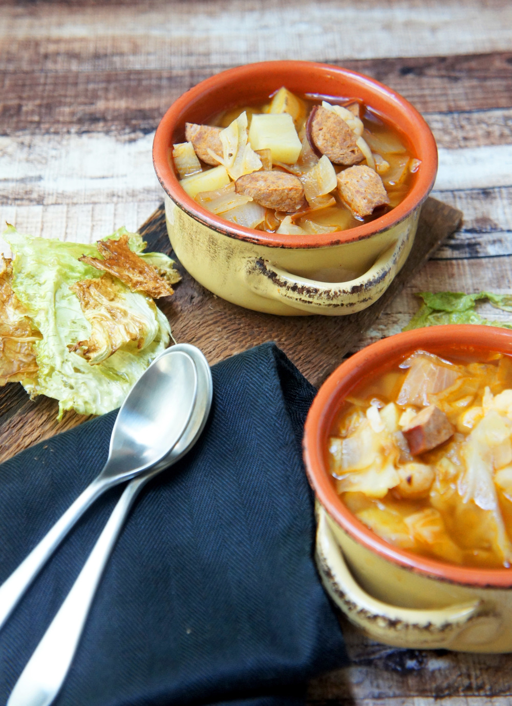 Kielbasa, Cabbage and Sweet Potatoes in a Smokey Paprika broth make for a homey, Hungarian-inspired stew. (paleo)