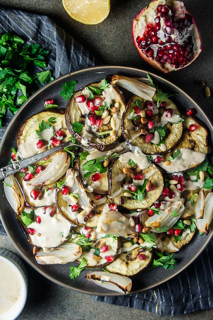 Roasted Eggplant Salad  with pomegranate, pine nuts, and tahini sauce