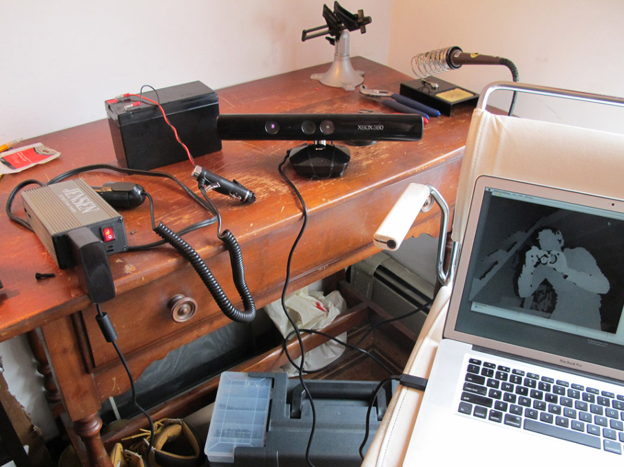 A motorcycle battery, laptop & inverter.