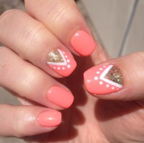 Neon orange and triangle nail-art from Tootsie Toes SF off Polk and Washington