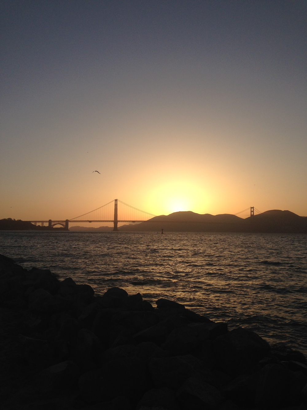 This is an unfiltered view of the Golden Gate bridge at Sunset at the Marina Green in San Francisco