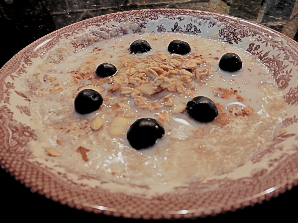 This is one of my favorite breakfasts ever. Steel cut oatmeal cooked thoroughly, with added milk, cinnamon, fresh blueberries and slivered almonds. I like to add a bit more milk on top after its fully cooked so it doesn't get hard in the bowl. So delicious.