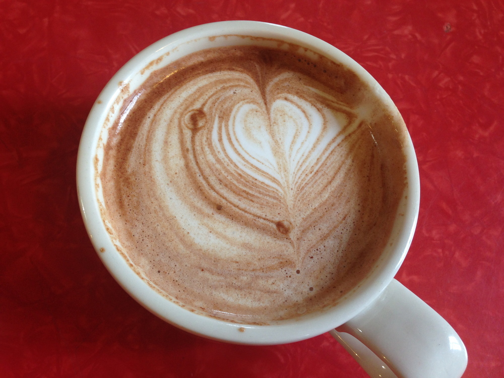 My boyfriend's hot chocolate. The heart was full, but he took a sip before I could get the perfect photo :)