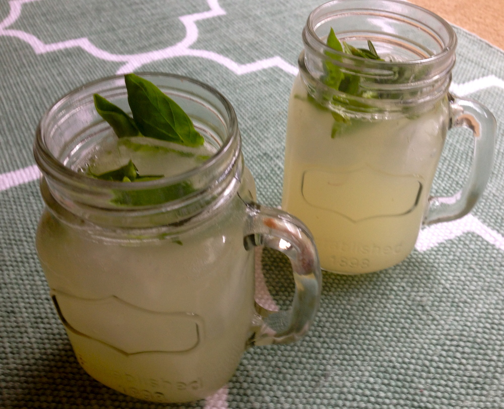 Freshly squeezed, basil, rosemary lemonade.  2 cups freshly squeezed lemon juice 2 cups soda water a few sprigs of basil, one tendril of rosemary  stir, pour over ice and enjoy!
