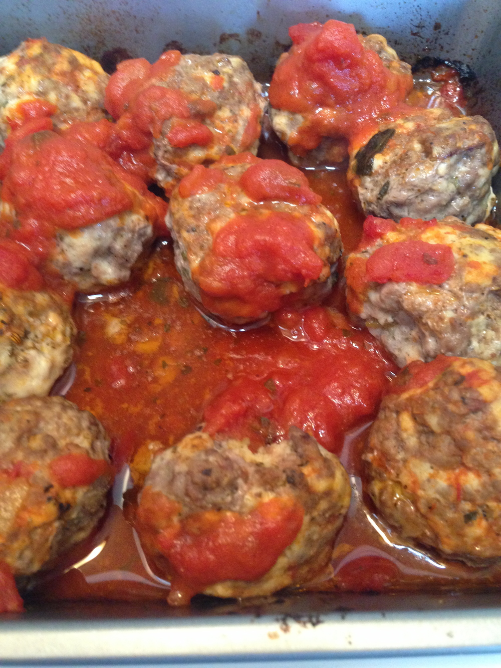 One trick to moist meatballs is taking them out of the oven and adding some more red sauce before placing them back in the oven for the last 5 - 7 minutes.
