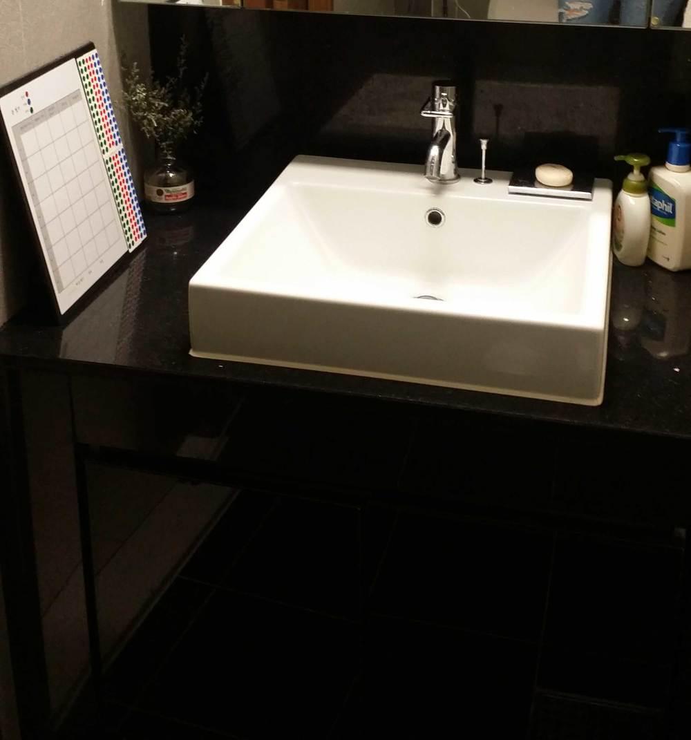 """Post Your Habits"" board in bathroom"