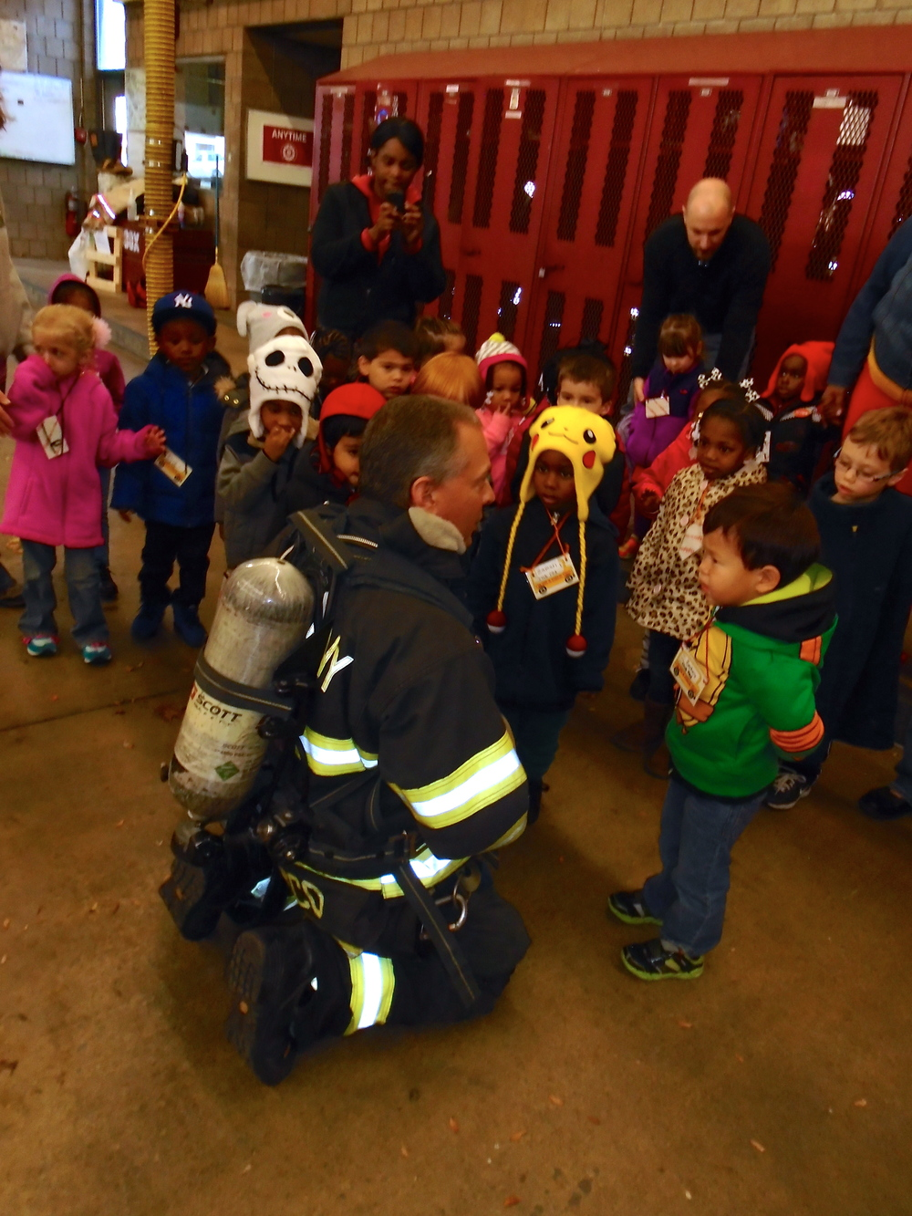 Examining the firefighter without his mask...