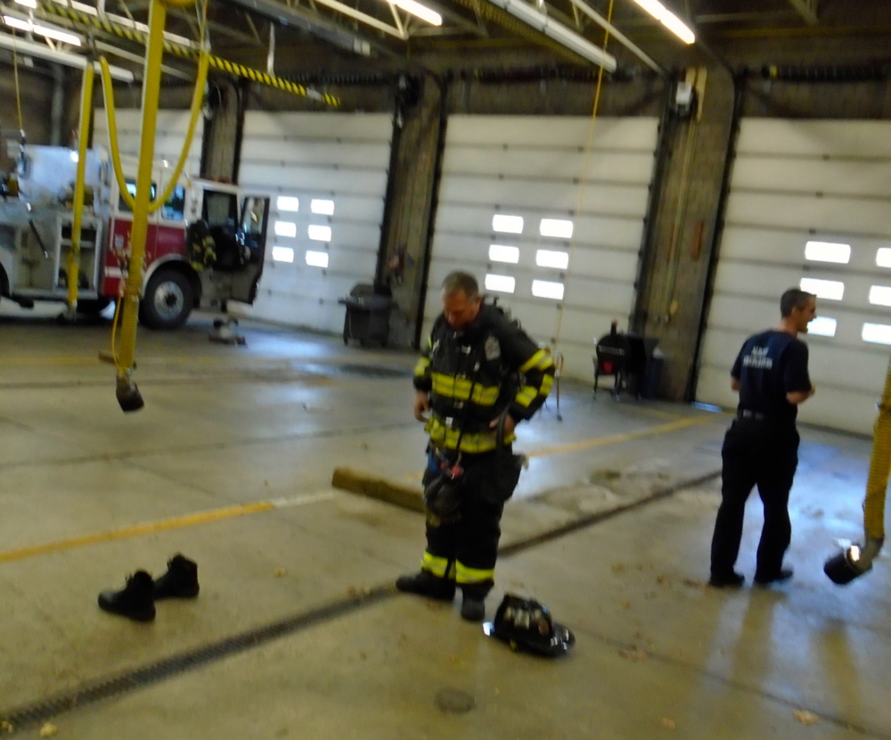 Showing us how they get ready before going into a fire!