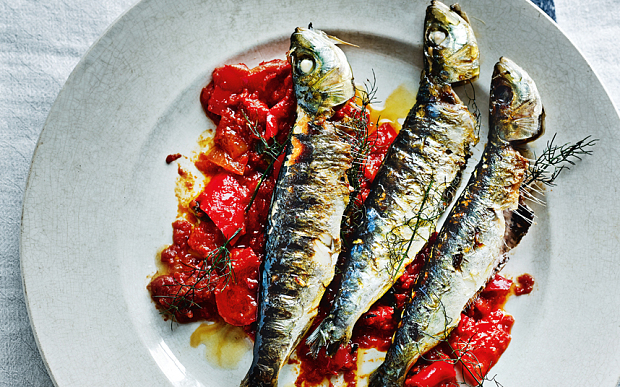 Grilled sardines on tomatoes. So delicious. You want to get small fish or fish that is tested mercury-free though!