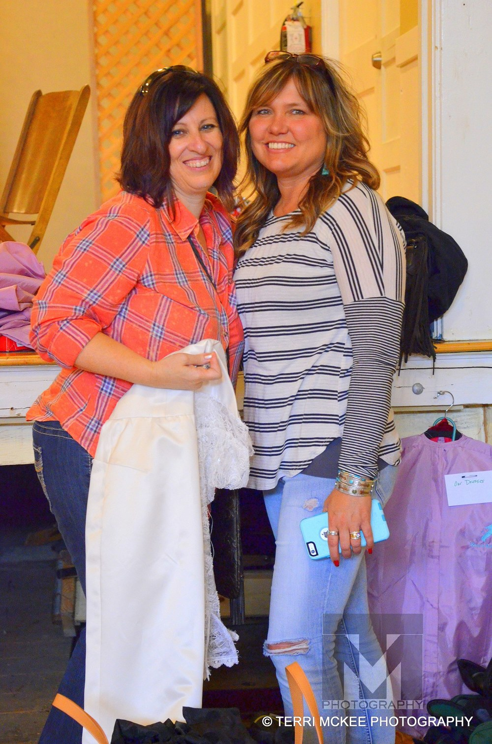 Ronda Thornburg and  Sue Ellen Correa helping out backstage. // Photo by Terri McKee