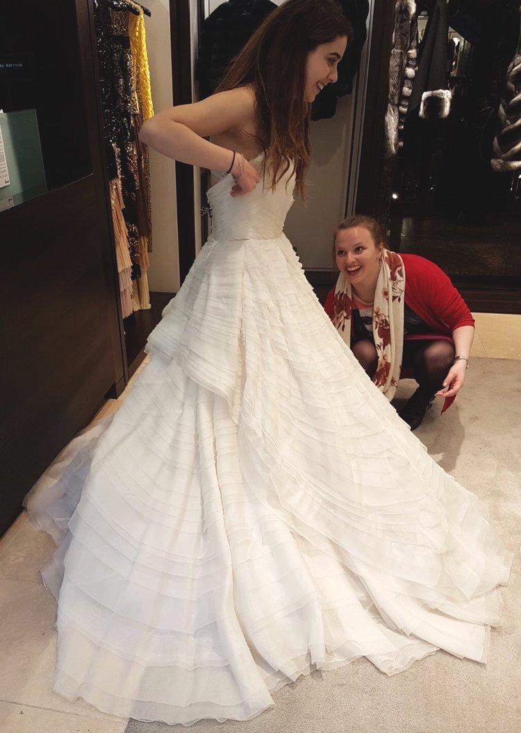 Tina trying on a $20,000 wedding gown at Harrod's