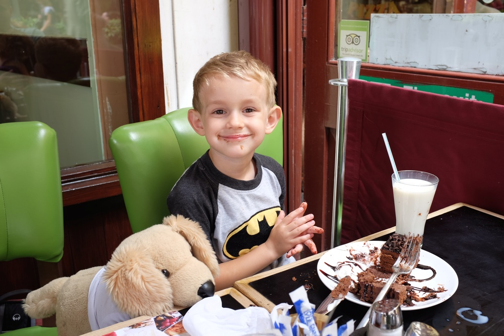 Kian and Boney the dog enjoying a delicious chocolate pastry