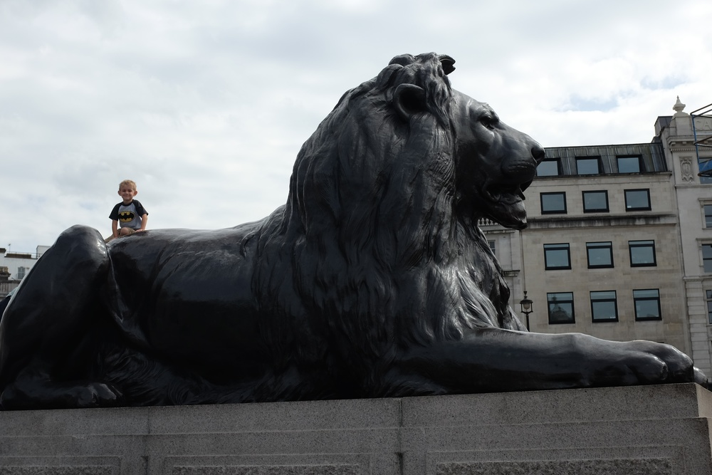 Kian on the back of one of the lions