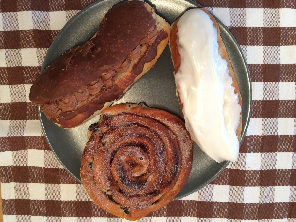 Chocolate Eclaire, Vanilla Pastry, and Cinnamon Danish