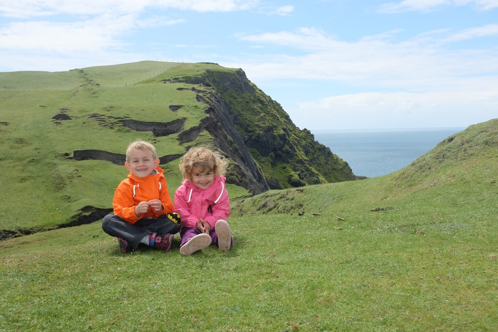 Kian and Hannah on the hills/cliffs by the Clare Island light house