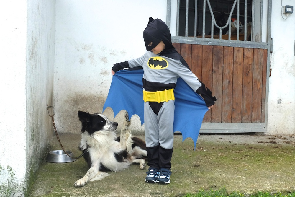Sam checking out Batman's cape