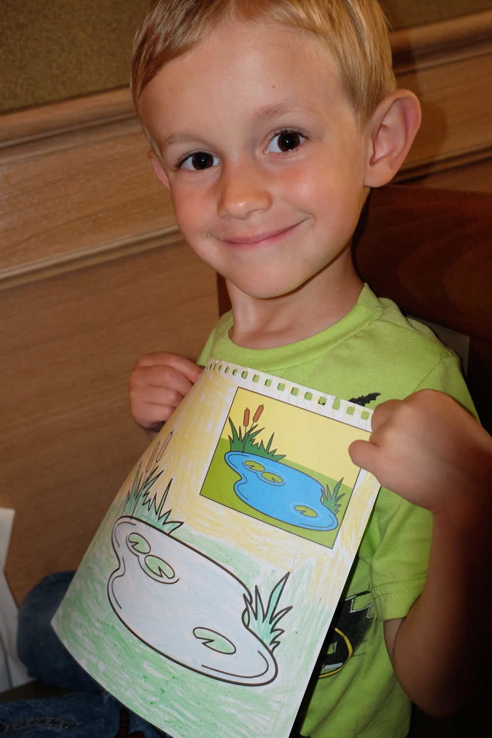 Kian and his coloring page at the restaurant :)