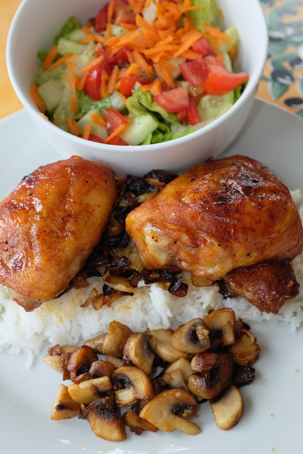 Chicken thighs baked in the oven atop rice with a side of mushrooms + a side salad