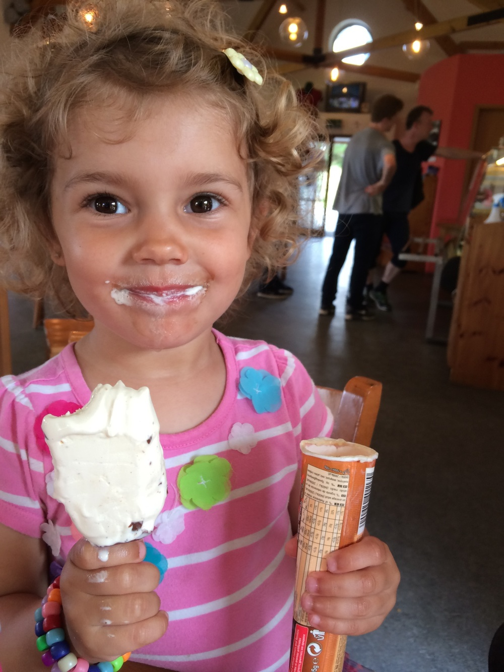 Hannah finishing Kian's ice cream and her own