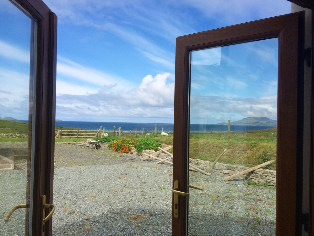 Gorgeous view of the sky and ocean from the kitchen door
